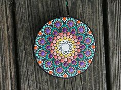 Beautifully colorful one-of-a-kind collectible wooden hand-painted dot mandala round box with detailed sides! Box design is inspired by Aboriginal Art with vibrant yellow, orange, purple and green details. Box has a removable top with magnetic closure and the inside is painted