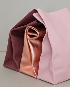 It was the gorgeous color palette of designer Annett Bourquin's paper bag-like leather clutches that first caught my eye. Then, it was discovering the modest simplicity of the bag's silhouette that had me smitten. Each of Annett's bags are crafted with a single piece of leather, fasted with a