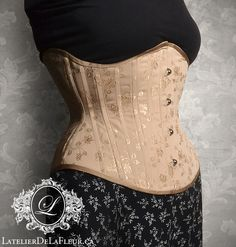 This underbust corset was made for a client with scoliosis. As you can see from the first wearing, the busk is nice and vertical, something that would not be possible with a symmetrical corset. Eventually this piece will lace closed (a little extra room is visible in the hips here). It's always a treat when a client wants to wear their new corset home from their pick-up appointment because they love the feeling so much. Many thanks to my client Margot for allowing me to take some photos of her! Toronto, Boned Corsets, Scoliosis, Underbust Corset, Couture, Bespoke, Sequin Skirt, Steel, Nice