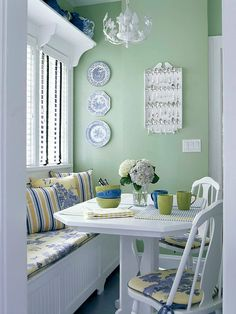 The window seat is used here to add further seating for guest in this apartment dining room. Decorated in shabby chic blending Light Room Colors green and blue . - Love the color palette. Banquette Design, Kitchen Banquette, Dining Nook, Kitchen Nook, Eat In Kitchen, Banquette Bench, Kitchen Chairs, Nook Table, Dining Chair