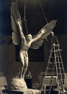 """valscrapbook:  xplanes: """"Soaring like an eagle into new heavens of valor and devotion"""" Gutzon Borglum standing next to """"The Aviator"""" (via)"""