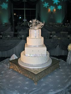 Sparkly wedding cake with one of Prism Crystal Bouquets' feathered cake toppers
