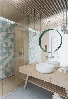 Salle de bain nature/turquoise. What an interesting design with pale wood, tiled accent wall, and mirror mirror.