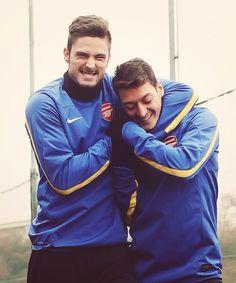 Giroud & Mesut. Isn't it bromantic? Özil's face says it all