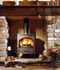 Like wood stove in rock, w/ hearth. but I think I like rock behind. more slanted walls reflecting heat out into the room- like big beam & rustic feel. Wood Stove Surround, Wood Stove Hearth, Fireplace Built Ins, Stove Fireplace, Fireplace Remodel, Fireplace Ideas, Wood Fuel, Slanted Walls, Log Burner