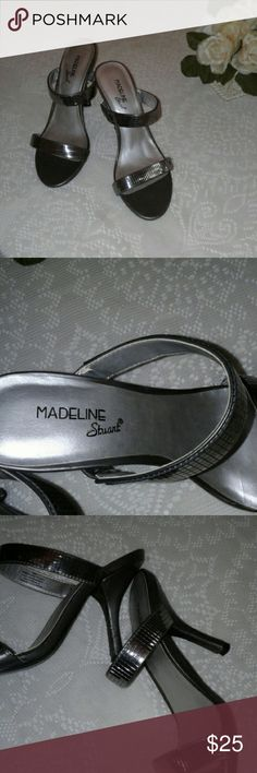 Madeline Stuart party heels silver size 7 These beautiful Madeline Stuart reflective silver strappy heels have only been worn once. In great used condition. Sz. 7 medium. Madeline Stuart Shoes Heels