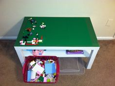 Lego table made from an Ikea coffee table and duct tape. The shelf is great for storage!
