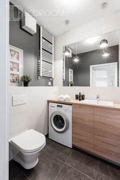 Baños de estilo moderno por Decoroom https://www.homify.com.mx/libros_de_ideas/3895881/15-disenos-de-cuartos-de-lavar-para-todos-los-gustos-y-estilos