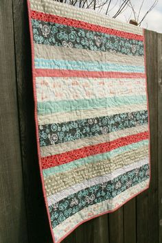 I love these strip quilts.  They seem so easy to do.
