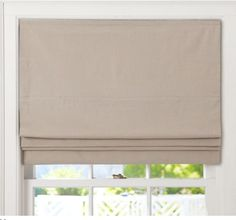 Roman shades for 4 French doors. Need to get rid of drapes that make family room look like a cave.