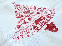 Red Christmas tree in cross stitch. Would make a lovely table cloth