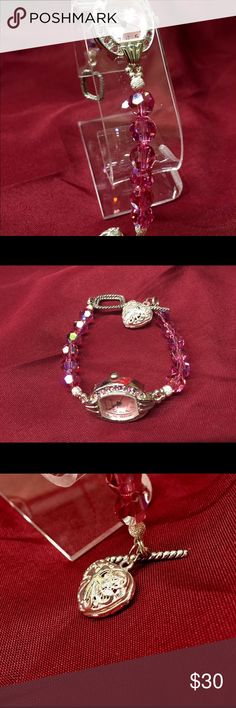 """New Watch Swarovski Embellishments This is a cute new Watch movement surrounded by pink rhinestones. The handcrafted band is 8mm Swarovski round beads. This watch band is only 6  1/2"""" for the small wrist. Silver plated diffuser. Handcrafted Accessories Watches"""