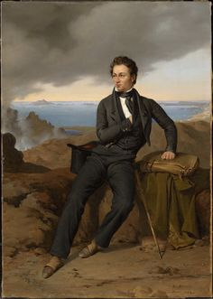 "Portrait of Théodore Jubin, 1826 by Guillaume Bodinier (French 1795–1872)....""Although the portrait of Jubin is clearly inscribed ""Rome 1826,"" it seems likely, given the sharp, rocky foreground hills rising from the bay below, and the mountainous island at the far left that Bodinier based this work on sketches he had made around the Bay of Naples and subsequently brought back to his Roman studio.'"