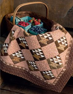 Cue beautiful basket blocks for a quilt-block swap! Berry Baskets by Jo Morton is a fun project for quilting friends. Choose an earthy palette of rich browns, tans, and taupes and set them off with a pink print.