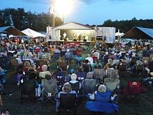 The Mount Airy Fiddlers Convention is a popular festival devoted to old-time and bluegrass music, as well as related arts such as dance, which takes place each summer at Veterans Memorial Park in Mount Airy, North Carolina, United States. It was established in 1972. It is held on the first weekend in June. The festival features numerous solo and band competitions, whose winners are awarded cash prizes.