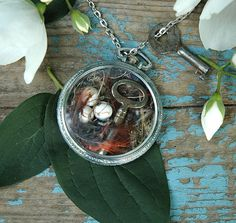 pocket watch necklace filled with birds net and key