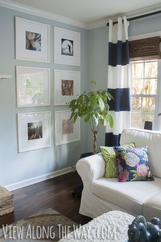 Warm Modern Decorating- Ideas and tutorials, including this picture frame wall by 'View Along the Way'!