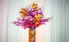 Shelby & Justin   Weddings in Tampa Bay   Borrowed & Blue   Hot pink and orange orchid centerpiece. #andrealaynefloraldesign #floridaaquarium #tampaweddings #lifelongstudios