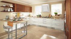 Georgia è una cucina versatile, perfetta per adattarsi alle diverse esigenze di arredamento con pensili e librerie studiate sia per separare che unire due spazi. #Lube #arredo #design #CucineLubeTorino #Cucine #Lube