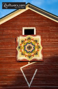 I was able to get a fantastic shot of the Priarie Star hanging from the Barn thanks to my photography assistant. :-) Again, made by Lauren Rogers from Backdoor Quilt Shoppe out of Reclaimed West fabrics! Timeless Treasures Fabrics, Inc. The Barn fabric in the border came from a photo taken inside the hay loft in that barn that it is hanging from. The Red fabric in the Star points was also from this same barn, but on the outside near the window and the door!