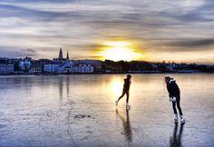 Morning ice skating on the lake in Reykjavik, Iceland.