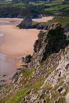 Three Cliffs Bay on the south coast of the Gower Peninsula, Wales. About 50 miles northwest of Llancarfan.