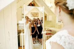 A fun wedding picture of the bride and bridesmaids   Photo by Hannah Schmitt Photography   Stunning Wedding Photos to Inspire Your Big Day!   Kennedy Blue