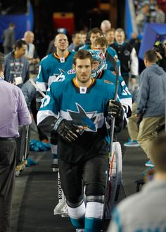San Jose Sharks forward James Sheppard is followed by goaltender Alex Stalock as they make their entrance for the Stadium Series game at Levi's Stadium (Feb. 21, 2015).