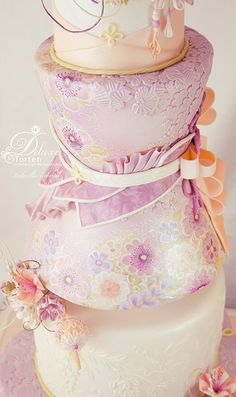 Cake inspired by Japanese Wedding Kimono and Kanzashi Flowers. Hand painted Details.  Entry for the British Sugarcraft Guild International Exhibition Telford 2016.  I won Gold and Trophy Best in Class in Masterclass Division.