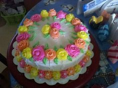#wiltoncontest  This to me made the cake by adding some more roses in the middle. This has been a great class with Mrs. Louise R. at the Hobby Lobby in Mobile, Alabama. Remember I was a beginner and now i can do this and more.