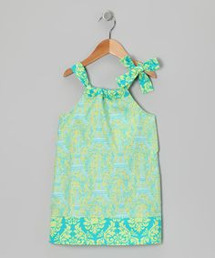 Girls with a bright sense of adventure find a happy home in this dress that comes in a vibrant mix of prints. Featuring a single tie, the neckline cinches in or out to create a look that's fun and comfortable while making new friends during afternoon outings.100% cottonMachine wash; tumble dryMade in the USA