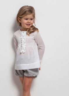 cute kids fashion idea with white blouse and gray shorts