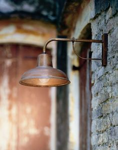 Exterior wall lamp by iL Fanale manufactured in Italy from a combination of solid copper and brass. iL Fanale uses a process on all of their outdoor lamps that results in a beautiful and natural ag . Café Exterior, Exterior Wall Light, Exterior Lighting, Home Lighting, Lighting Design, Club Lighting, Cottage Exterior, Backyard Lighting, Lighting Ideas