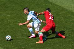Mehrdad Pooladi & Sergio Aguero : Argentina v Iran: Group F - 2014 FIFA World Cup Brazil