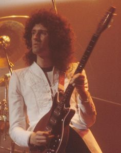 "Brian May - How amazing it had to be for those who had the opportunity to actually hear him play the guitar in any concert. Videos are marvelous, would be lost without them but to hear him IN PERSON...that would be the ultimate ""Brian May Experience""..."