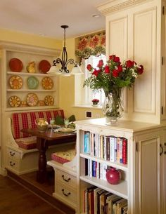 Kitchen nook - I especially like the shelves for cookbooks. Really interesting and practical use of space.