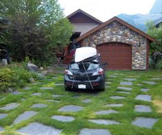 Driveway ideas like this flagstone path style, are a great way to add character to your front yard.