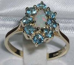 Womens Solid 18K Gold Natural Opal & Blue Topaz Elegant English Cluster Ring – Size 8 – Finger Sizes 4 to 12 Available http://www.easterdepot.com/womens-solid-18k-gold-natural-opal-blue-topaz-elegant-english-cluster-ring-size-8-finger-sizes-4-to-12-available/ #easter  This Unusual yet Classic Marquise Cluster Ring has been hand set with a Beautiful array of Sparkling High Quality Gemstones. The Center Marquise cut Opal measures 8x4mm (0.32″x0.16″) and is surrounded by eight 3mm (0.12..