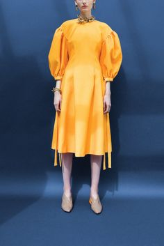 Puff Sleeve Dress in Marigold Bonded Crepe. Front pleats with sleeve tie detail and back zip fastening.SHOP THE LOOK:Clay Heels