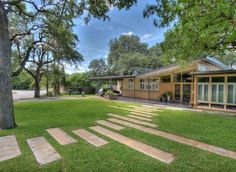 great mid-century ranch with landing strip staggered pathway..