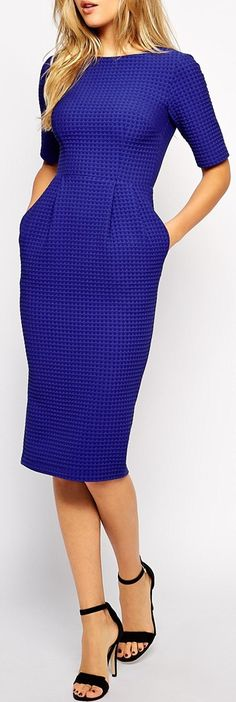 I am in LOVE with this beautiful midi dress! It is a beautiful color.