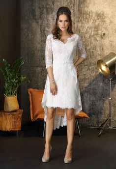 Contemporary and modern, this elegant tea-length wedding dress is styled with geometric floral all-over lace to create this magnificent gown. The sweetheart neckline is underneath soft delicate layers of lace, that form the three-quarter lace sleeves, finished with magnificent detail at the cuff. The dress is designed with a hi-low debatable overskirt, so that the bride can create a different look from ceremony to reception, if desired. Hi Low Wedding Dress, Tea Length Wedding Dress, Wedding Gowns, Modern Vintage Weddings, Vintage Inspired Wedding Dresses, Different Wedding Dress Styles, Lace Sleeves, Dresses With Sleeves, Courthouse Wedding