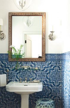 This Vintage Bathroom is beautiful with the ornate tilework, pedestal sink & lovely sconces on either side of the mirror.
