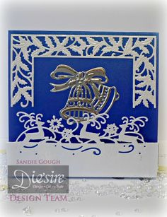 Sandie Gough - Die'sire Edge'ables Reindeer Leaping -  Die'sire Fancy Square Border: Holly - Die'sire Festive Square Accordion die set for centre Bell only - Centura Pearl Hint of Silver and Royal Blue - Collal All Purpose glue & Tacky glue -  Silver Mirri card - #crafterscompanion #Christmas