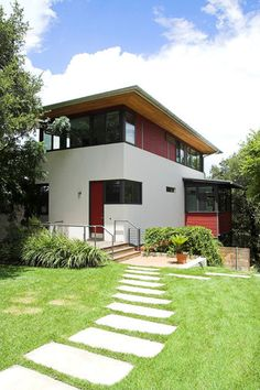 """nice exterior, also the red door, feng shui """"mouth of Chi"""" where energy enters the home."""