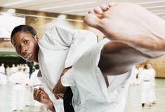 Photo of a woman doing a karate kick. Tae Bo, Air Max 2009, Air Max Thea, Taekwondo, Jessica Black, Nike Heels, Nike Headbands, Air Max Day, Martial Arts Women