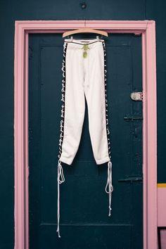 Inside Fashion Buyer and Editor Yuwei Zhangzou's Closet: White and Black Lace Up Sweatpants by Fenty Puma x Rihanna | coveteur.com