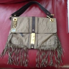 Authentic Lanvin Shoulder Bag! This bag is in excellent condition!  Some minor wear to front hardware but can only be seen when latch in the front is removed.  Bag has fringe dangling from it great for the bohemian look.  Inside of bag is clean. Lanvin Bags Shoulder Bags