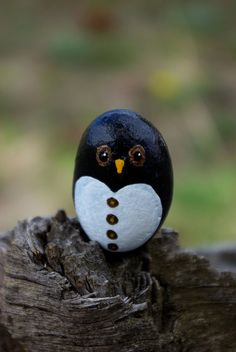 Smart and handsome little whimsical penguin rock by Livingpebbles