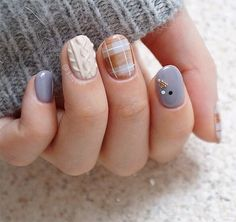 Make your nails look cozy with sweater nail art.